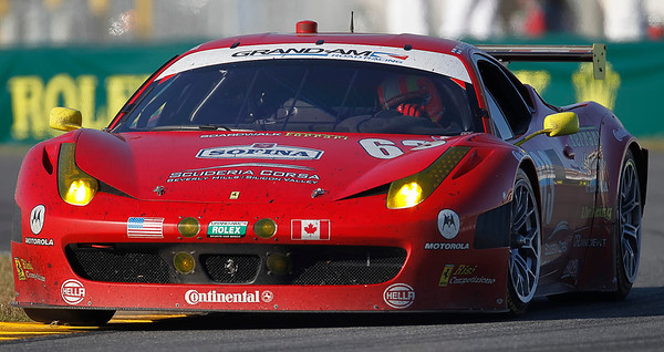 Risi Competizione Ferrari 458 accelerates out of the east horseshoe turn of the Rolex 24hr at the Daytona International Speedway on Sunday January 29, 2012