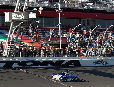 The #60 Michael Shank Racing Ford Riley car driven by A.J. Allmendinger takes the checkered flag of the Rolex 24hr at the Daytona International Speedway on Sunday January 29, 2012.