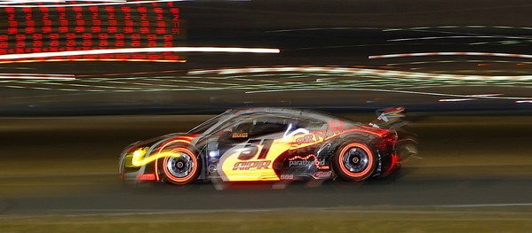 APR Motorsports #51 Audi R8's rotors glow bright red as it travels around the east horseshoe with its flame-like decals during the Rolex 24hr at Daytona International Speedway on Saturday January 28, 2012