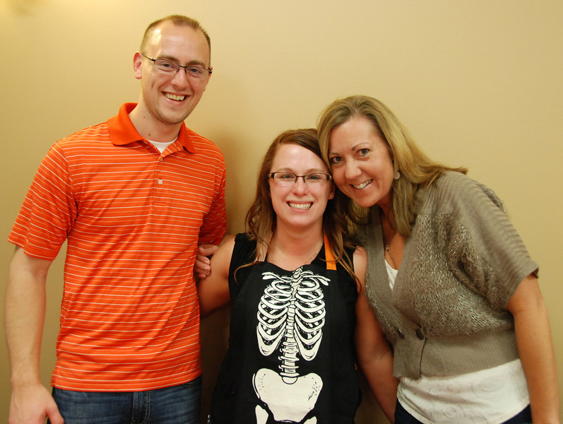 Jennifer Jorgensen (center), marketing director for Akridge & Akridge Chiropractic, with her hubby and hubby's aunt.