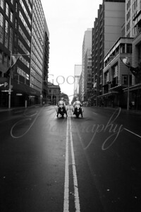 Two motorcycle police providing escort for the Walk with Christ procession through the heart of Sydney's CBD.