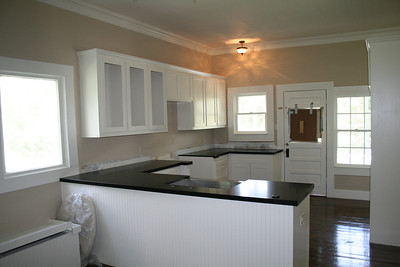 renovation almost complete.  New window seat/ storage in, newly configured kitchen with custom cabinets and honed granite, apron sink.