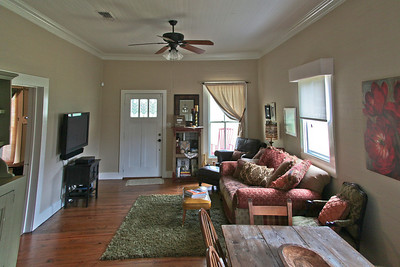 Living/dining room with original knotty pine wood floors