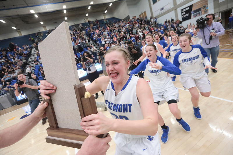 Fremont players celebrate after defeating Bingham, 61-47, winning the UHSAA 6A Girls State Basketball Championship on Saturday, Feb. 24, 2018, at Salt Lake Community College in Taylorsville.