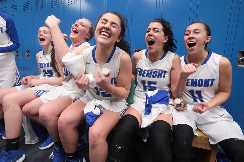 Fremont players celebrate in the locker room after defeating Westlake, 54-50, in overtime during the UHSAA 6A Girls State Basketball Tournament on Friday, Feb. 23, 2018, at Salt Lake Community College in Taylorsville.
