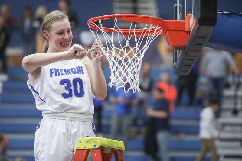 Fremont's Berkley Larsen (30) cuts off a piece of net after defeating Bingham, 61-47, winning the UHSAA 6A Girls State Basketball Championship on Saturday, Feb. 24, 2018, at Salt Lake Community College in Taylorsville.