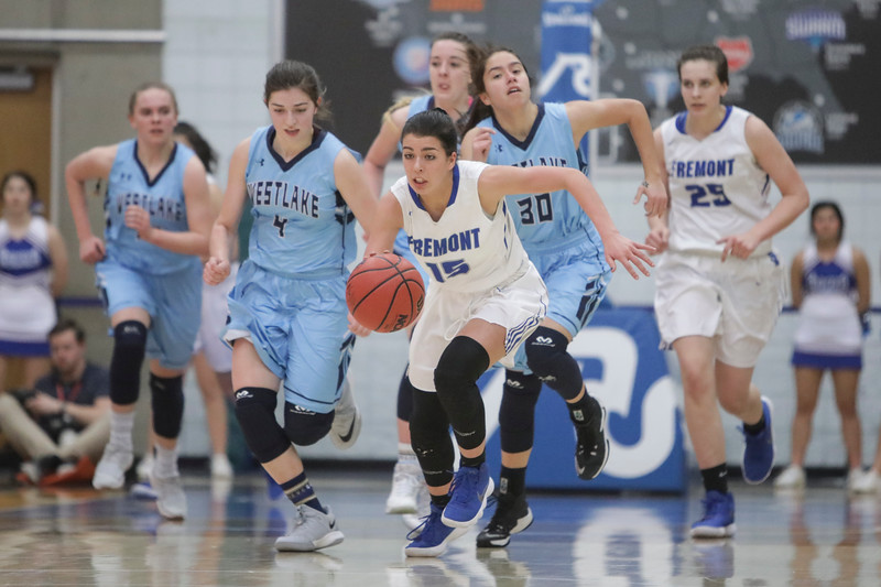 Fremont's Mazzie Melaney (15) drives down the court past a group of Westlake defenders during the UHSAA 6A Girls State Basketball Tournament on Friday, Feb. 23, 2018, at Salt Lake Community College in Taylorsville. Fremont went on to defeat Westlake, 54-50, in overtime.