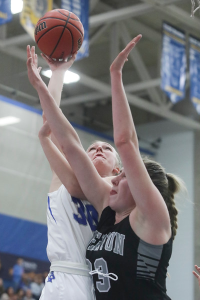 Fremont's Berkley Larsen is fouled by Riverton's Morgan Kane (33) in the first half of the UHSAA 6A Girls State Basketball Tournament on Thursday, Feb. 22, 2018, at Salt Lake Community College in Taylorsville. Fremont went on to defeat Riverton, 48-46.