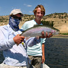 Guide Doug Mcknight and Pierce Edlich with a slab lake rainbow. <br /> Photo: TJ Edlich