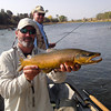 Guide Dave Bryan holds up a solid Valley brown caught by Tim Stand. <br /> Photo: Eileen Collopy