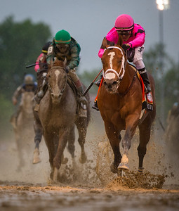 Maximum Security crosses under the wire first in the Kentucky Derby before being disqualified for interference.