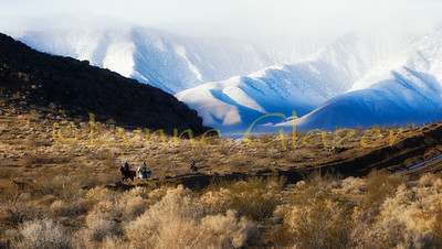 Riders flanked by the Eastern Sierras as they ride along a natural gas pipeline project at the Death Valley Warmup 50.