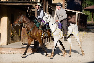 Rick and Suzanne King ride through the western town at Paramount Ranch during the Malibu ride.  He's on Rebecca Florio's mare Kay (Ready Set Go).  Suzanne is on Cynthia Binder's QH-Arab Orion.  Orion has 500 LD miles and has been the first mount for many.  Orion's other job is as a upper level dressage horse!