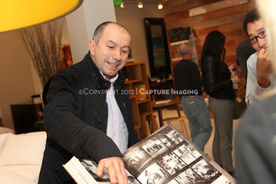 "1211269-027    A book signing of ""The Wild Horses of Sable Island"" by photographer Roberto Dutesco at the Environment showroom at South Coast Plaza on Thursday, Nov. 29, 2012, in Costa Mesa, Calif. (Photo by Michael Rueter/Capture Imaging)"