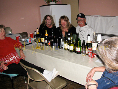 27winky_0559  The dancers take a break surrounded by the bottles consumed during dinner and the awards afterwards.  Really.  Don't you believe me?