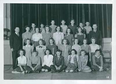 Dora Hendricksen.  2nd Row 1st person.