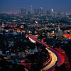 Downtown Los Angeles skyline in the evening with highway 101 traffic