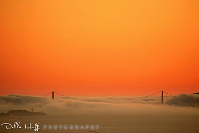 Stunning Orange Sunset Over Golden Gate Bridge and Fog
