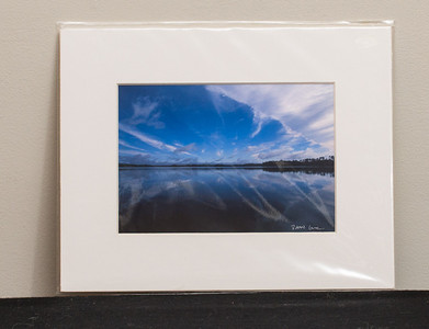 SALE DETAILS:   8x10 Matted print (in protective package)                             $10 (does not include sales tax or shipping).  Original price: $40/each  IMAGE DETAILS: 15130-1 English Channel Clouds