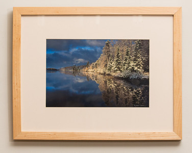 "SALE DETAILS:   14x18 Framed print with off-white mat and solid Birch frame (3/4"" deep)                             $55 (does not include sales tax or shipping).  Original price: $225  IMAGE DETAILS:  9678-3 Birch Lake Snow"