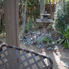 BACK: View of fountain from back deck. River stone and succulents.