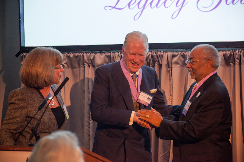 """The Historical Society of Washington, D.C.'s 2013 Legacy Gala honored the Quander and Saul families. The event, held at the Society's home in the Carnegie Library building at Mt. Vernon Square also marked the reopening of the """"Window to Washington"""" exhibit (including more than 25 newly curated artworks). New acquisitions to the collections were displayed in the Kiplinger Research Library, and guests were introduced to the Urban Photography Series,  a grant-funded project which was launched by the Society in spring 2013.  Speakers: HSW chair Julie Koczela; emcee Mark Plotkin; Deputy Mayor for Public Safety and Justice Paul Quander;  Dr. Ida Jones of the Moorland-Spingarn Research Center at Howard University; honoree Rohulamin Quander; 2012 honoree Austin H. Kiplinger; and honoree B.F. Saul II.<br /> Shot 11/13/2013"""
