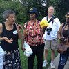 The Society's Urban Photography Series includes guided photo tours of neighborhoods in each of the District's eight wards. The tour of  Brightwood (Ward 4) was led by Pat Tyson. <br /> <br /> PICTURED:  Participants and tour guide along the route. Outside the former Military Road School; tour guide and women in white t-shirt are former students at the Military Road School.<br /> <br /> Shot 6/29/2013. Credit: Anne McDonough, © Historical Society of Washington, D.C.