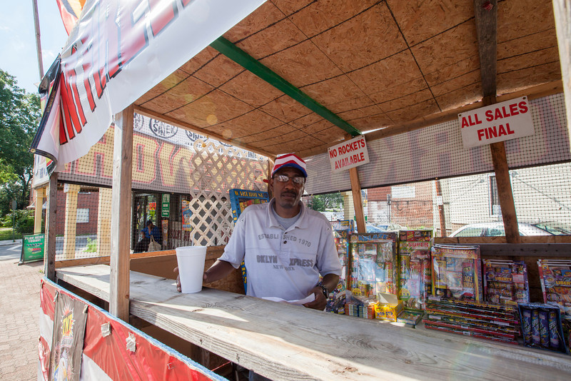 The Society's Urban Photography Series includes guided photo tours of neighborhoods in each of the District's eight wards. The tour of  Brightwood (Ward 4) was led by Pat Tyson. <br /> <br /> PICTURED: Fireworks vendor outside Missouri Avenue Market (5900 Georgia Avenue NW). <br /> <br /> Shot 6/29/2013. Credit: Anne McDonough, © Historical Society of Washington, D.C.