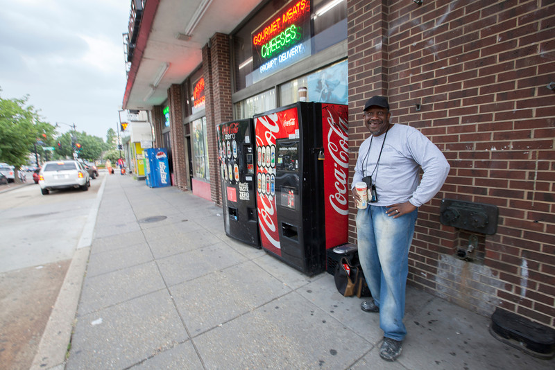 The Society's Urban Photography Series includes guided photo tours of neighborhoods in each of the District's eight wards. The tour of Connecticut Avenue/Cleveland Park (Ward 3) was led by Carolyn Crouch.<br /> <br /> PICTURED: Panhandler posing outside Brookville Supermarket, 3427 Connecticut Avenue NW.<br /> <br /> Shot 7/27/2013. Credit: Anne McDonough, © Historical Society of Washington, D.C.