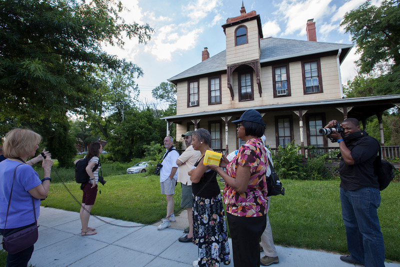 The Society's Urban Photography Series includes guided photo tours of neighborhoods in each of the District's eight wards. The tour of  Brightwood (Ward 4) was led by Pat Tyson. <br /> <br /> PICTURED:  Participants and tour guide along the route. Loretta Neumann talking about the George M. Lightfoot Family Residence, 1329 Missouri Avenue NW.  <br /> <br /> Shot 6/29/2013. Credit: Anne McDonough, © Historical Society of Washington, D.C.