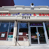 The Society's Urban Photography Series includes guided photo tours of neighborhoods in each of the District's eight wards. The tour of Park View (Ward 1) was led by Kent Boese. <br /> <br /> PICTURED: Lion's Wine and Spirits, 3614 Georgia Avenue NW.<br /> <br /> Shot 6/22/2013. Credit: Anne McDonough, © Historical Society of Washington, D.C.