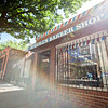 The Society's Urban Photography Series includes guided photo tours of neighborhoods in each of the District's eight wards. The tour of Park View (Ward 1) was led by Kent Boese. <br /> <br /> PICTURED:  Spruill's Bluebird Barbershop, 3219 Georgia Avenue NW. <br /> <br /> Shot 6/22/2013. Credit: Anne McDonough, © Historical Society of Washington, D.C.
