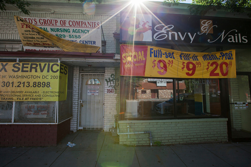 The Society's Urban Photography Series includes guided photo tours of neighborhoods in each of the District's eight wards. The tour of Park View (Ward 1) was led by Kent Boese. <br /> <br /> PICTURED: Envy Nails & Spa, 3723 Georgia Avenue NW.<br /> <br /> Shot 6/22/2013. Credit: Anne McDonough, © Historical Society of Washington, D.C.