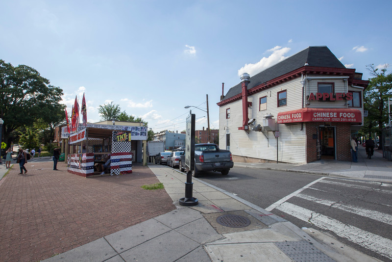 The Society's Urban Photography Series includes guided photo tours of neighborhoods in each of the District's eight wards. The tour of  Brightwood (Ward 4) was led by Pat Tyson. <br /> <br /> PICTURED:  Fireworks vendor outside Missouri Avenue Market ( 5900 Georgia Avenue NW) and Apple Chinese Food (5910 Georgia Avenue NW).<br /> <br /> Shot 6/29/2013. Credit: Anne McDonough, © Historical Society of Washington, D.C.