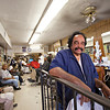 The Society's Urban Photography Series includes guided photo tours of neighborhoods in each of the District's eight wards. The tour of Park View (Ward 1) was led by Kent Boese. <br /> <br /> PICTURED:  Spruill's Bluebird Barbershop, 3219 Georgia Avenue NW. James Spruill, pictured. <br /> <br /> Shot 6/22/2013. Credit: Anne McDonough, © Historical Society of Washington, D.C.