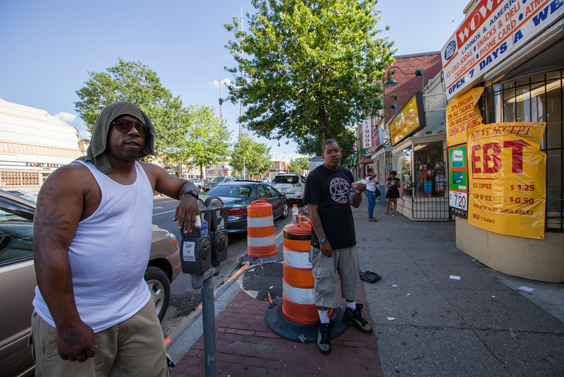 The Society's Urban Photography Series includes guided photo tours of neighborhoods in each of the District's eight wards. The tour of  Brightwood (Ward 4) was led by Pat Tyson. <br /> <br /> PICTURED: Keeping cool on a hot day, Georgia Avenue near Rittenhouse Street NW.<br /> <br /> Shot 6/29/2013. Credit: Anne McDonough, © Historical Society of Washington, D.C.