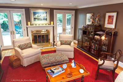 Spacious formal living room with fireplace, double french doors to the zen-like outdoors and relaxing screen room.