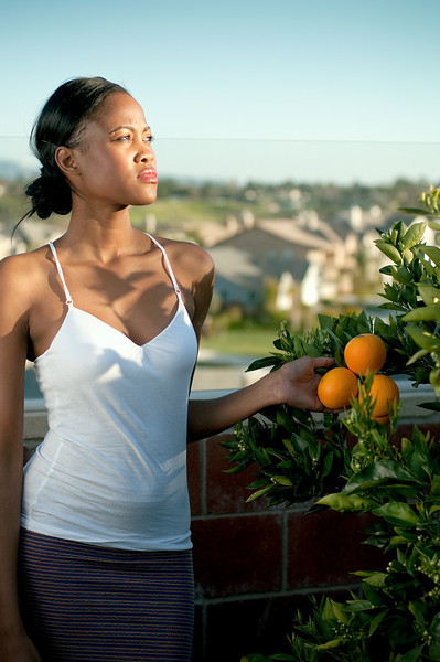 Young Woman With Oranges