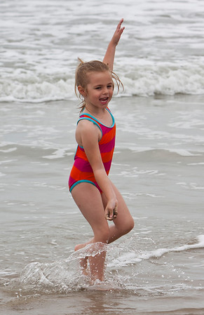 Looks like she is trying to surf.............hey a surfer girl is up and comeing