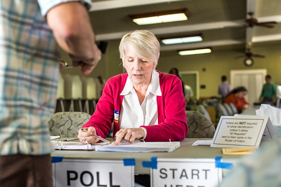 Poll worker Sue Staatz checks in a voter at Poll A. The Sierra 2 Center is a dual voting place, serving two adjacent precincts in the greater Curtis Park area.