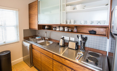 07  Kitchen View with open drawer showing plates, cups and cutlery