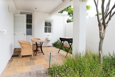 08  Patio view with braai and chairs and open door