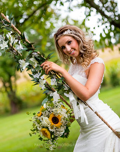 Bride on swing with Sunflowers