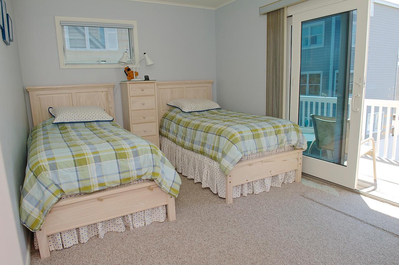 Second floor bedroom with deck.