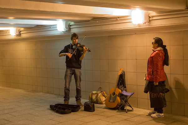 I had heard that professional musicians do street performing for extra cash. I think I found one, as this guy was unbelievably talented. I noticed that women who were enamored by street musicians would stand close within their private space to listen and stare.