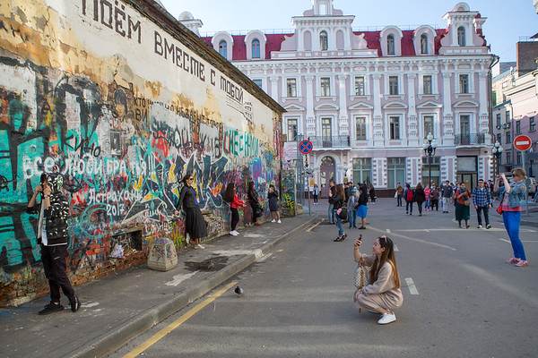 A side street of the main Arbat Street  shopping area. You didn't see much graffiti in the city, but my guess is this is a place where it is allowed. People would line up to have their pictures taken.