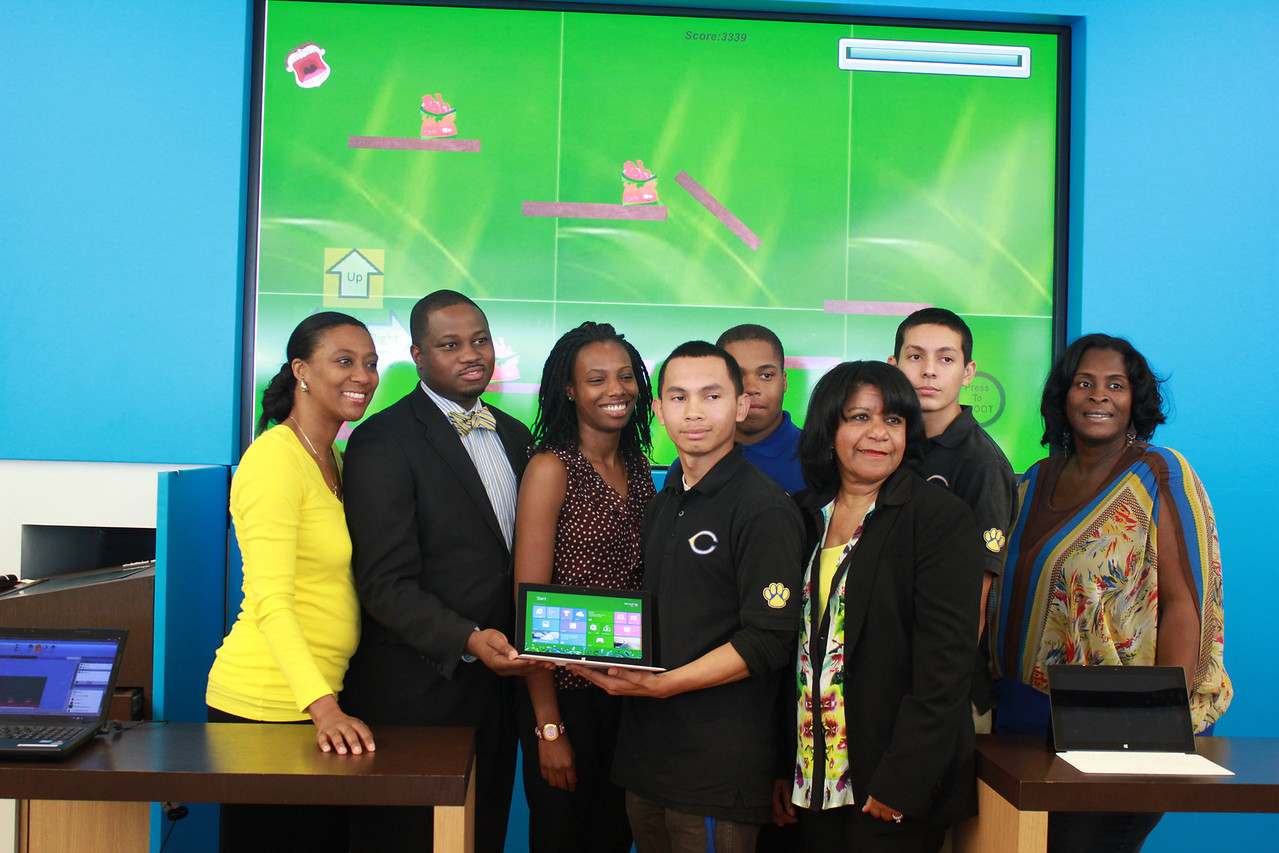 From left M.O.M. Program founder Daphne Bradford, Crenshaw High School Prinicpal Remon Corley, Kevin Rivers Holding the game displayed on a Surface Tablet, flanked by two reps from LAUSD School Board member Marguerite Poindexter LaMotte, Domonic WIlks and Esaul Parra, the other two designers and Jacqueline Lopez, Biology teacher and leadership