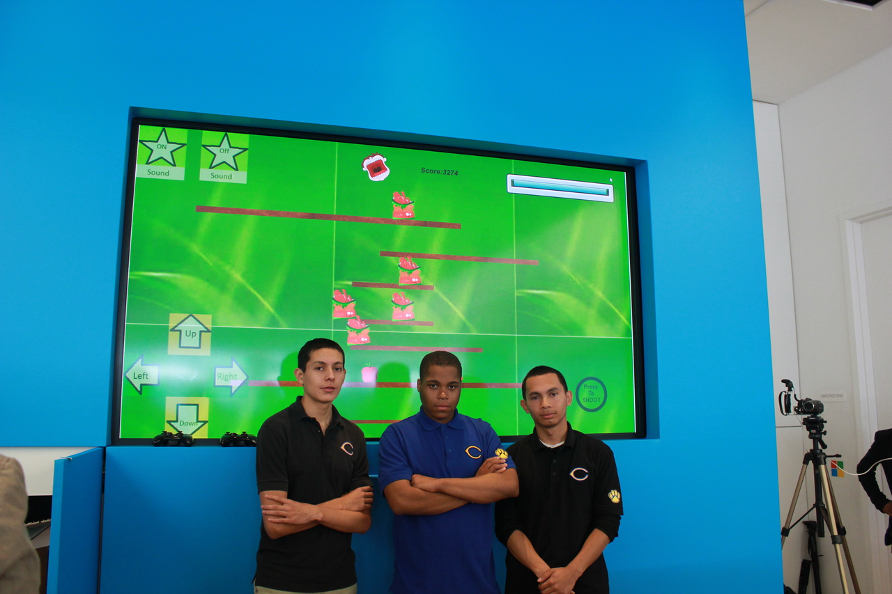 From left: Esaul Parra, Domonic Wilks and Kevin Rivera, moments before they debuted their Going Bananas for Health game app, inspired by their work tending to their garden at Crenshaw High School where they are seniors, and members of the CHS Digital Media Team.  Photo by Isidra Person-Lynn