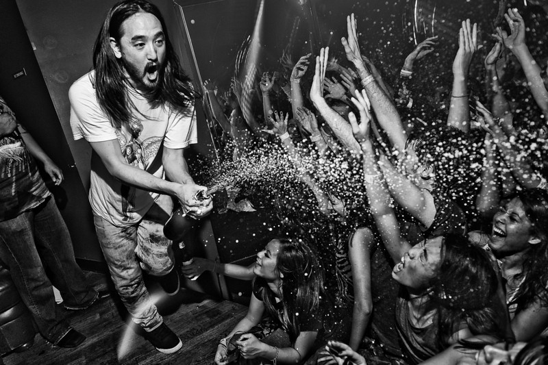 "Steve Aoki<br /> Hollywood, CA<br /> <br /> The man behind Dim Mak Records who founded and released artists from Bloc Party, The Kills, Klaxons, MSTRKRFT, The Bloody Beetroots, Mystery Jets, The Rakes, The Gossip, Envy, also is the same man behind the production moniker Weird Science that has remixed Peaches, Snoop Dogg & Bloc Party. Under his own name, Aoki has remixed The Killers, Robin Thicke, Lenny Kravitz, Duran Duran and Timbaland, Chester French, S.P.A., All American Rejects, Chris Cornell & more. In the past he has collaborated w/artists from Boys Noize, The Faint, D.i.M., The Bloody Beetroots, & Junkie Xl. Also involved in fashion, Aoki has developed lines for KR3W Apparel, Supra Footwear, headphones for WESC, and in '09 sunglasses with KSUBI, headwear with NEFF, bags with Burton, & a brand new mens/women's range with his sister Devon. Check out  <a href=""http://www.dimmakcollection.com"">http://www.dimmakcollection.com</a> to buy tee shirts & hoodies and read on his blog on here that he keeps up to date. Hailing from Los Angeles you can check most of his antics up on his partner in crime's website  <a href=""http://www.TheCobrasnake.com"">http://www.TheCobrasnake.com</a>."