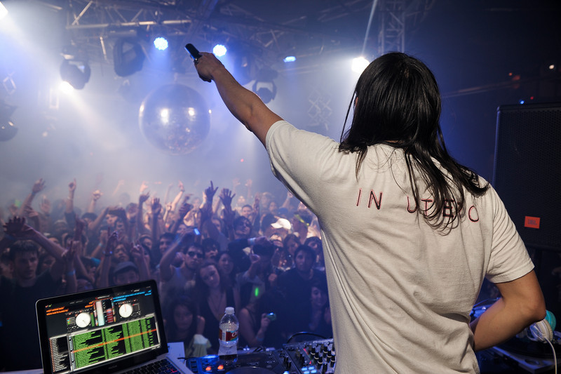 """Steve Aoki<br /> Hollywood, CA<br /> <br /> The man behind Dim Mak Records who founded and released artists from Bloc Party, The Kills, Klaxons, MSTRKRFT, The Bloody Beetroots, Mystery Jets, The Rakes, The Gossip, Envy, also is the same man behind the production moniker Weird Science that has remixed Peaches, Snoop Dogg & Bloc Party. Under his own name, Aoki has remixed The Killers, Robin Thicke, Lenny Kravitz, Duran Duran and Timbaland, Chester French, S.P.A., All American Rejects, Chris Cornell & more. In the past he has collaborated w/artists from Boys Noize, The Faint, D.i.M., The Bloody Beetroots, & Junkie Xl. Also involved in fashion, Aoki has developed lines for KR3W Apparel, Supra Footwear, headphones for WESC, and in '09 sunglasses with KSUBI, headwear with NEFF, bags with Burton, & a brand new mens/women's range with his sister Devon. Check out  <a href=""""http://www.dimmakcollection.com"""">http://www.dimmakcollection.com</a> to buy tee shirts & hoodies and read on his blog on here that he keeps up to date. Hailing from Los Angeles you can check most of his antics up on his partner in crime's website  <a href=""""http://www.TheCobrasnake.com"""">http://www.TheCobrasnake.com</a>."""